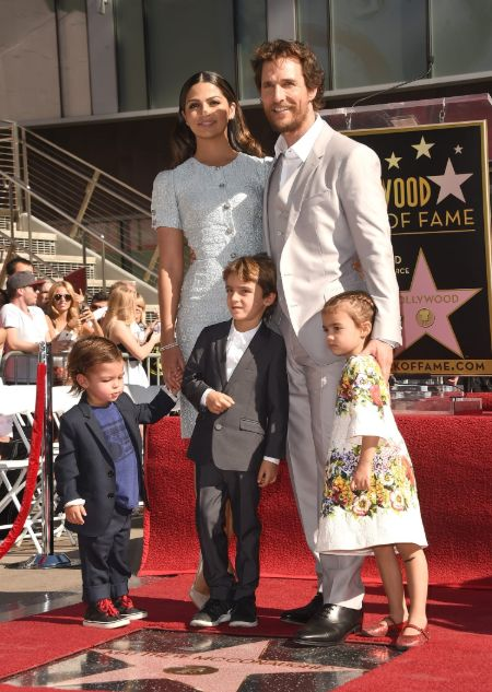 Matthew McConaughey and Camila Alves with their kids at Matthew's Hollywood Walk of Fame ceremony. Everybody is dressed top notch and the kids look very cute.
