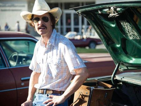 "Matthew McConaughey in his role of Ron Woodroof in ""Dallas Buyers Club.' Matthew sports a cowboy had a sunglasses. He looks lean and also has a mustache."
