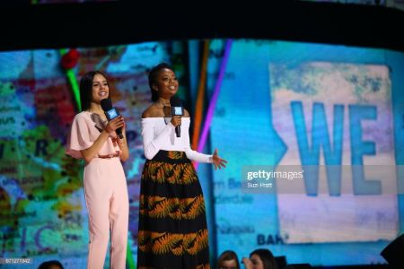 jenna on stage with a social activist on the WE event