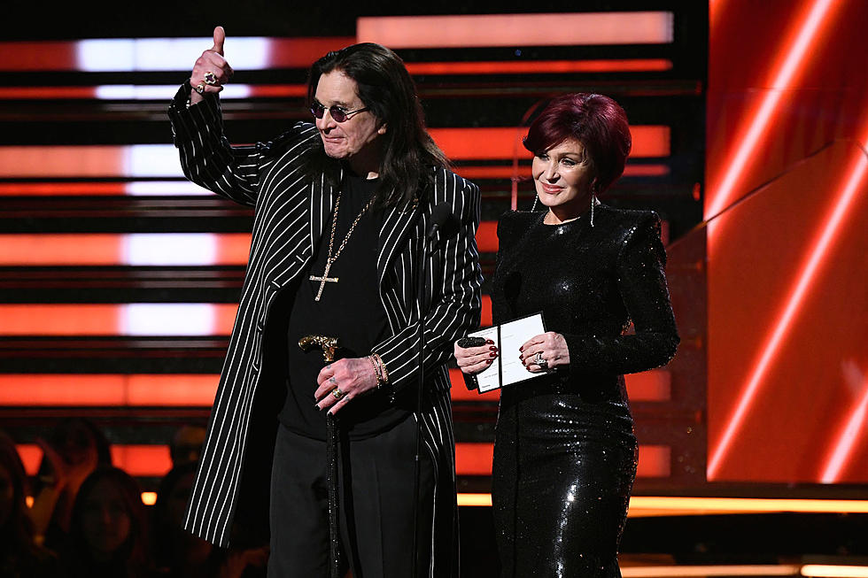 ozzy with wife sharon on stage announcing awards