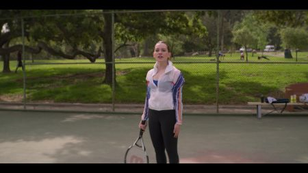 love quinn holding a tennis racket