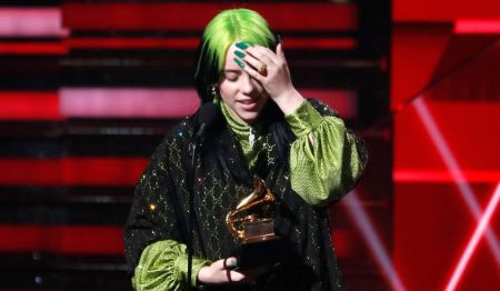 billie on the stage holding a grammy