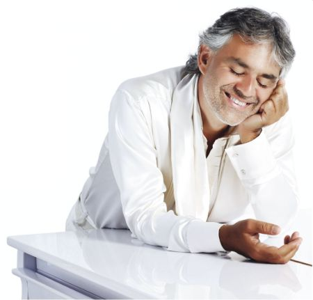 Andrea Bocelli poses in all white attire. His net worth is $40 million.