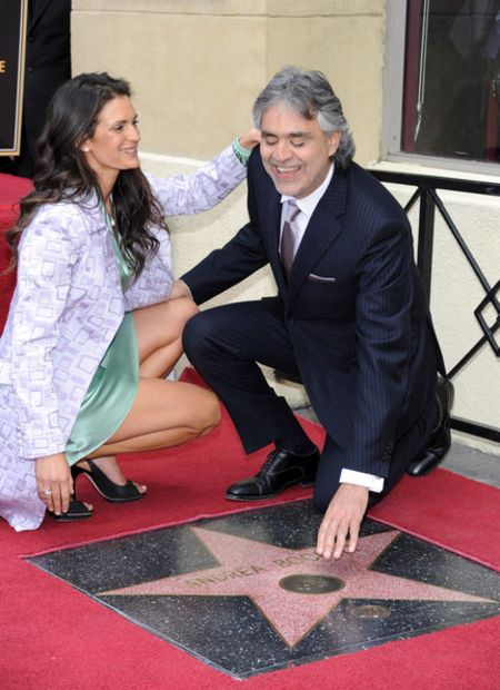 Andrea Bocelli happily touches down on his Hollywood Walk of Fame star with his current wife Veronica Berti.