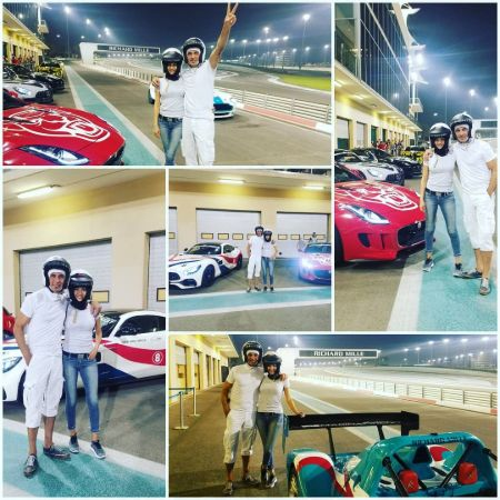 Instagram Picture of Shaun and his wife riding race cars in Abu Dhabi.