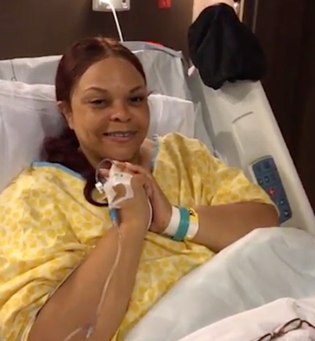 tamela in the hospital bed wearing a yellow hospital gown