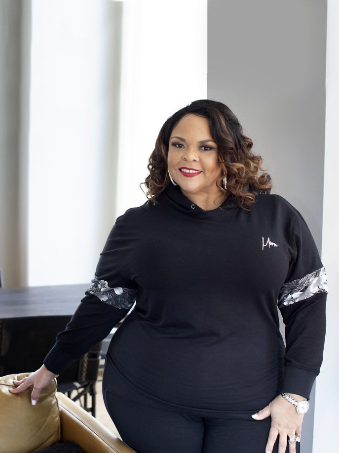 tamela in a black sweatshit and leggings