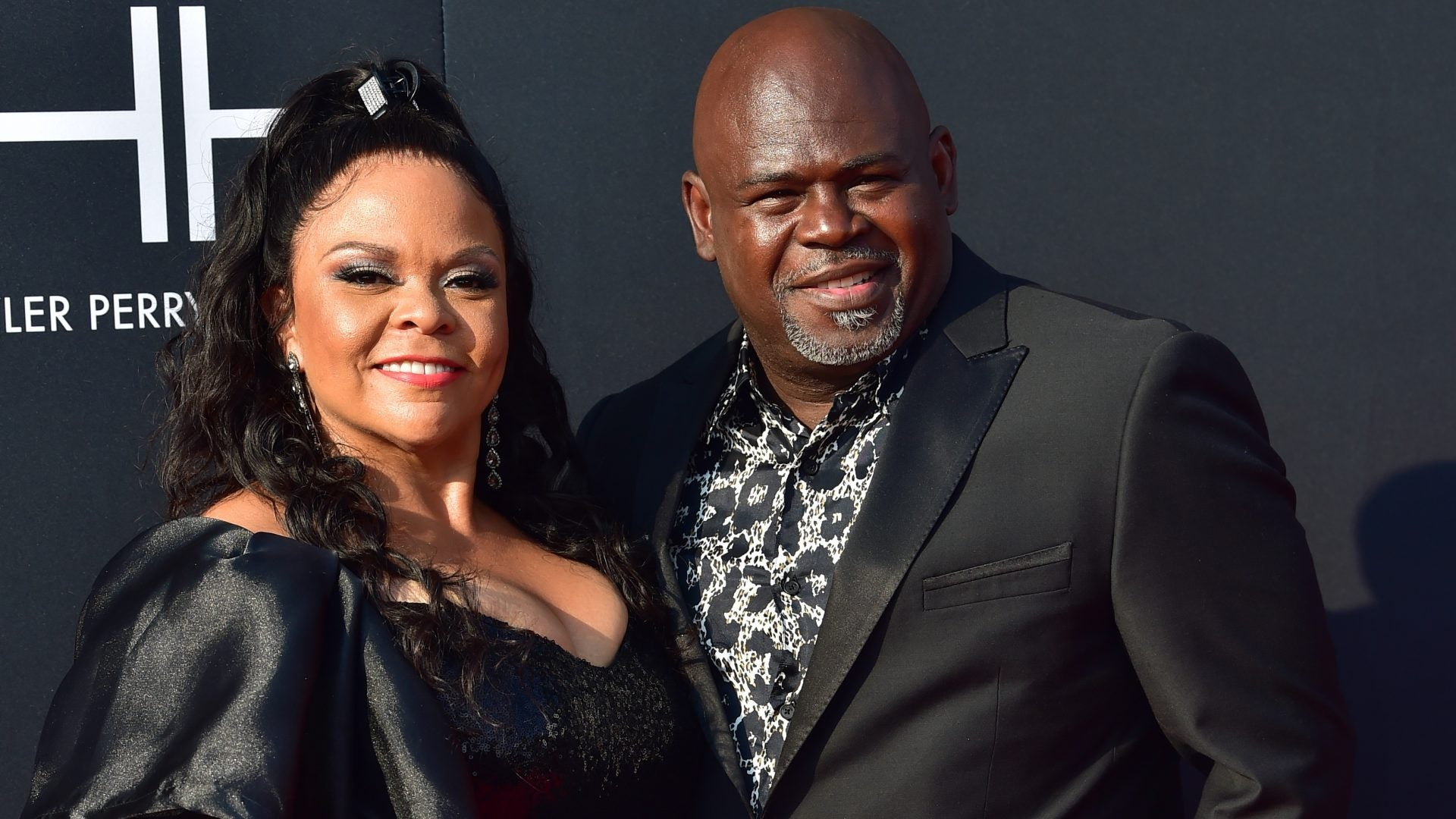 tamela with husband both wearing black
