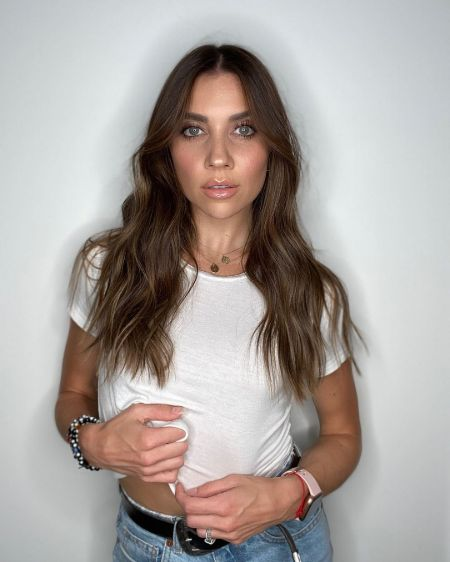 Jenna Johnson poses a picture in a white t-shirt,