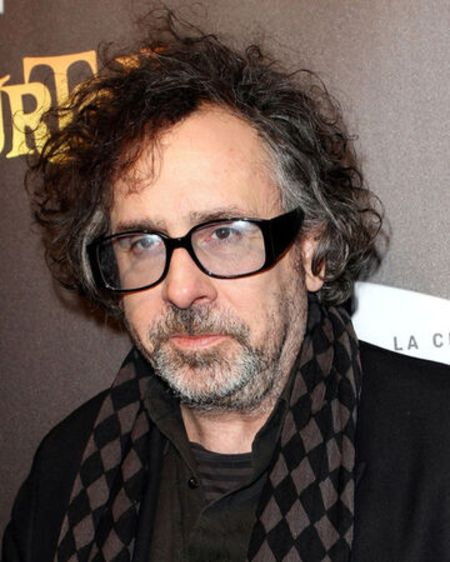 Tim Burton in a black suit and t-shirt caught in the camera.
