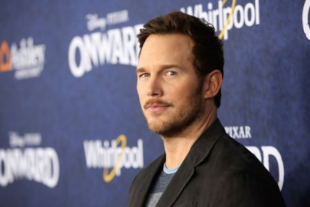 Chris Pratt in a brown coat caught on the camera.