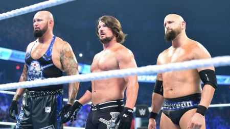 Karl Anderson alongside AJ Styles and Luke Gallows caught on the camera.