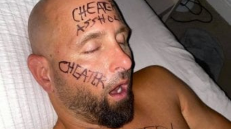 Karl Anderson's wife wrote cheater on his face.