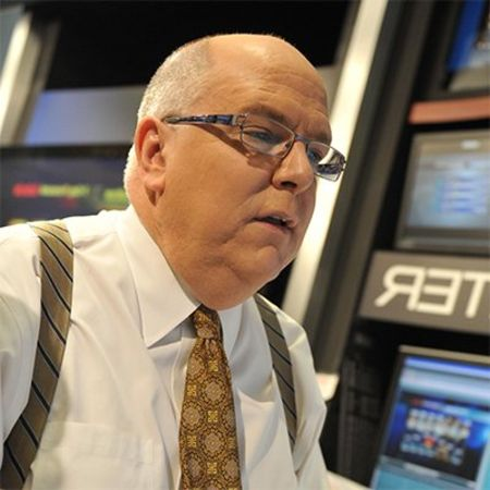Tom Skilling in a white shirt caught on the camera.
