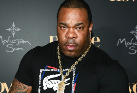 Busta Rhymes in a black t-shirt poses a picture.