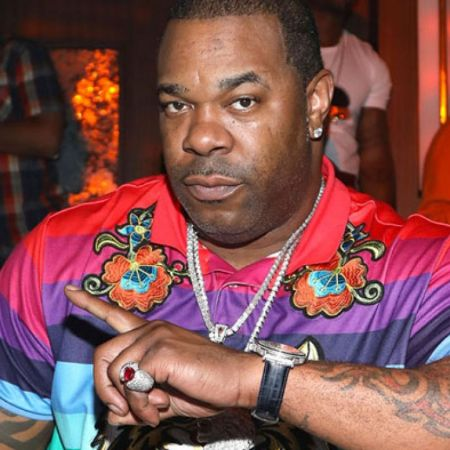 Busta Rhymes in a colorful picture poses a picture.