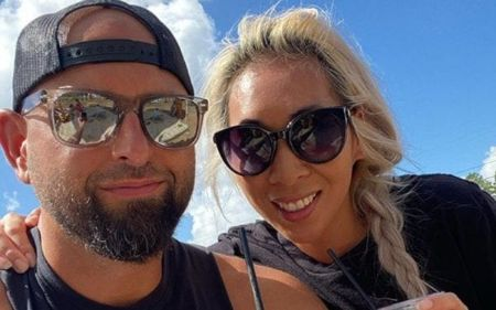Karl Anderson and his wife Christine Bui pose for a picture.