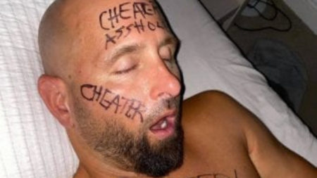 Karl Anderson's wife wrote cheater on his face and posted on Instagram.