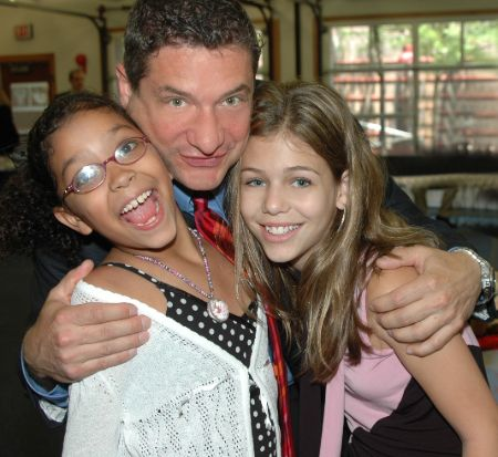 Rick Leventhal poses a picture with his two daughters.