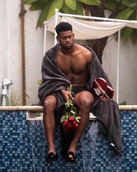 Juju Smith-Schuster alone holding a rose in the Valentine's day.