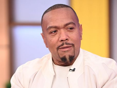 timbaland in an interview wearing a white suit