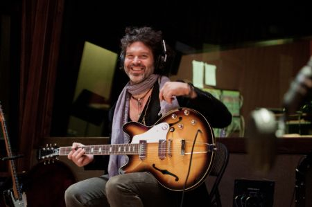 Doyle Bramhall II plays his guitar strung upside-down.