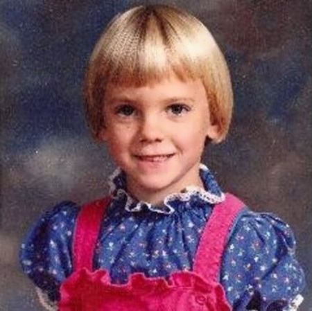 baby anna with a bob cut ruffled shirt with pink suspanders