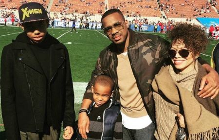 Tisha Campbell-Martin in brown with her two sons and ex-husband.