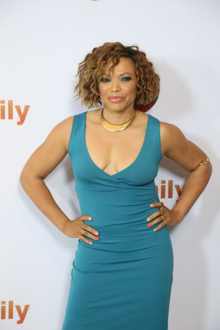 Tisha Campbell-Martin in a green dress.