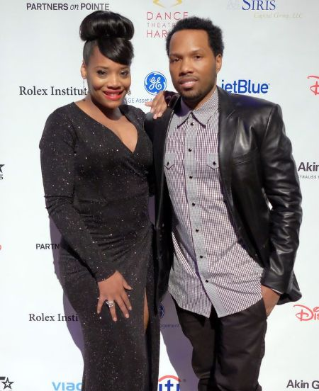 Mendeecees Harris in right poses with his wife Yandy Smith at an event.