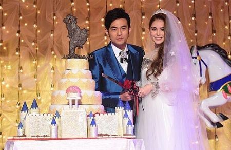 Hannah Quinlivan in a wedding gown with her husband Jay Chou at their wedding ceremony.