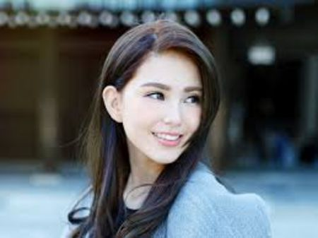 Hannah Quinlivan in a blue sweater poses for a picture.