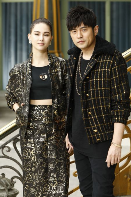 Hannah Quinlivan in a black dress with her husband Jay Chou.