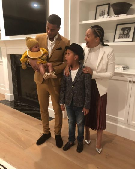 Cory Hardrict and wife Tia Mowry pose a picture with thier children.