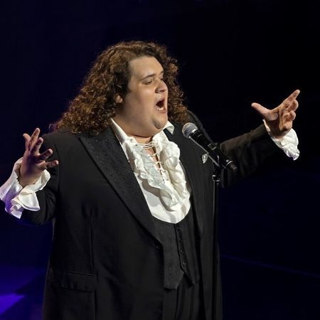Jonathan Antoine performing in front of live audience.
