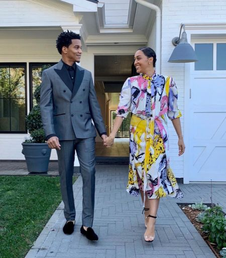 Tia Mowry and her husband Cory Hardrict pose for a picture in front of their house.
