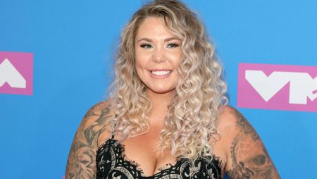 Teen Mom star Kailyn Lowry in a black top poses for a picture.