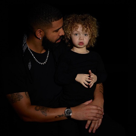 Drake with his son Adonis.