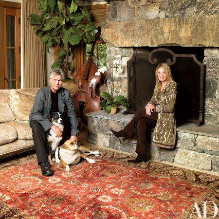 Richard Dean Anderson and his partner pose at their Malibu house with their two dogs.