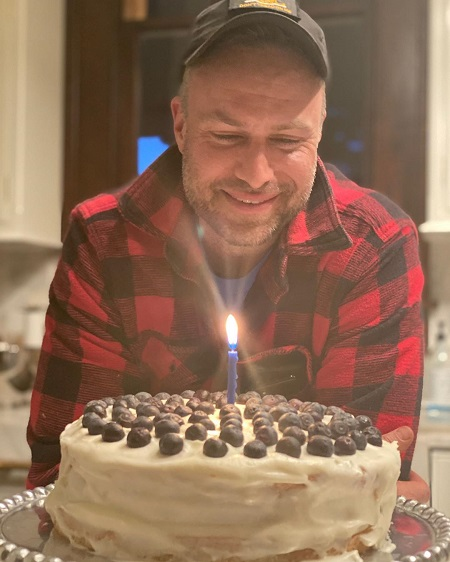 David Lemanowicz about to blow the single candle on a cake during his birthday. Net Worth Reveal.