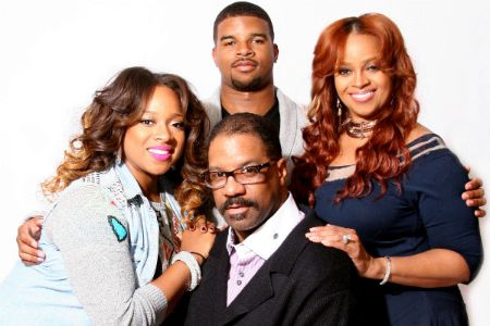 John Drew Sheard poses a picture with his sister Kierra Sheard, mother Karen Clark Sheard and father John Drew Sheard.
