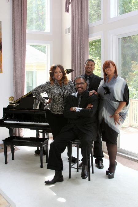 Drew Sheard II in a black shirt poses with father John Drew Sheard, sister Kierra  Sheard and mother Karen Clark Sheard.