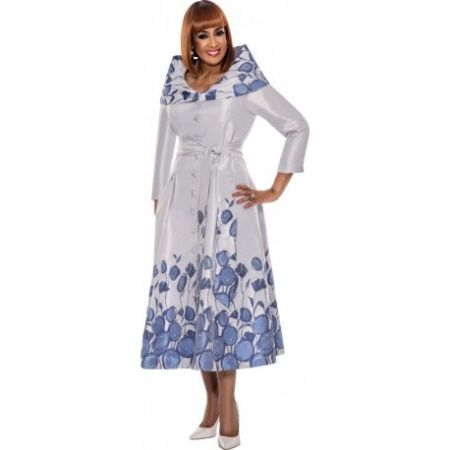 Dorinda Clark-Cole in a white dress poses for a picture.
