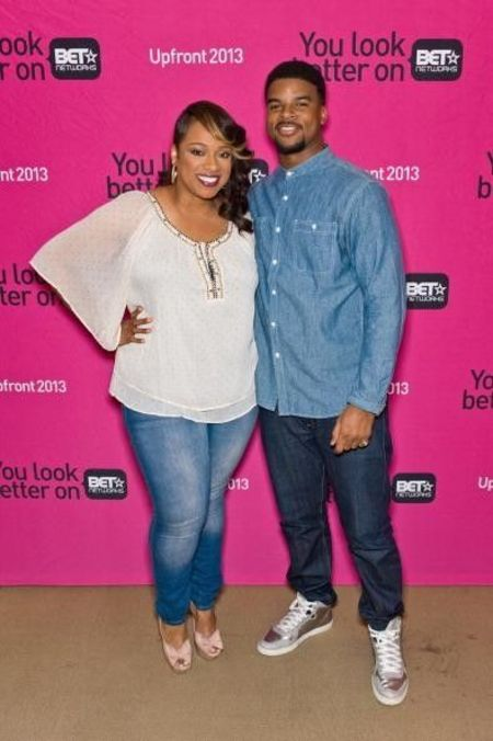 John Drew Sheard in a blue shirt poses with sister Kierra Sheard.