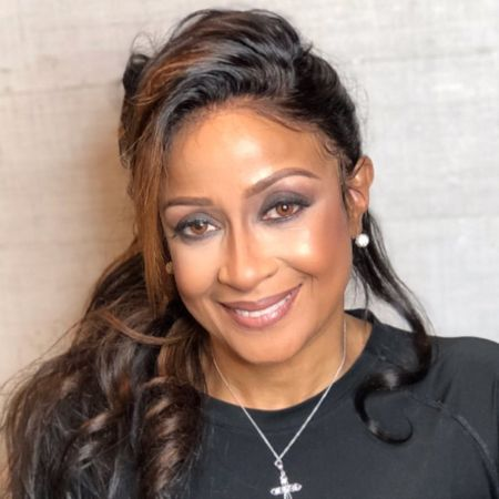 Dorinda Clark-Cole in a black top poses for a picture.