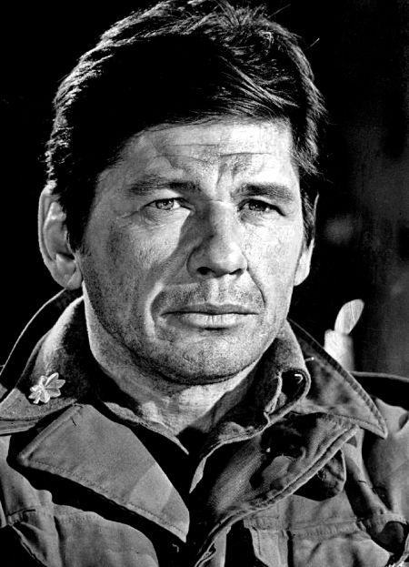 Late actor Charles Bronson picture in a jacket.