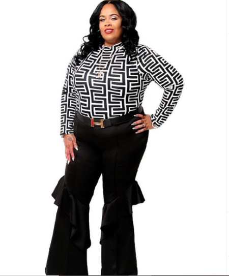 nikkia wearing a black and white stripped top with a black ruffled pants