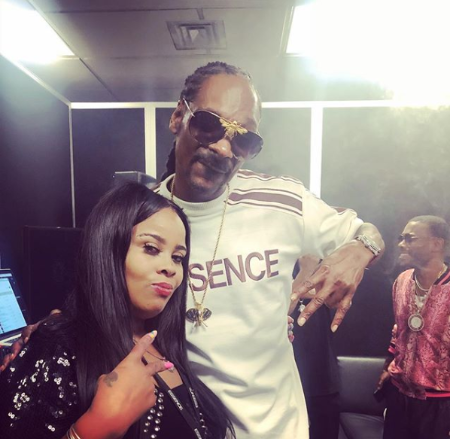 nikkia with snoop dog backstage, snoop hugging nikki from the side