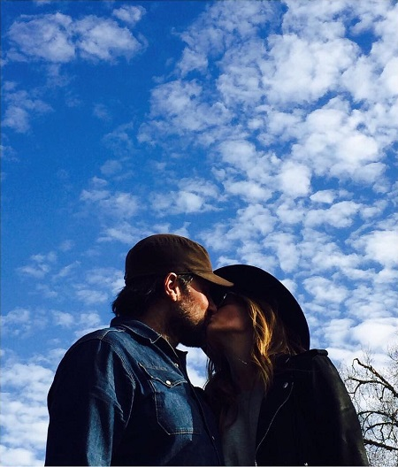 Stana Katic and husband Kris Brkljac kissing each other on New Year 2017.