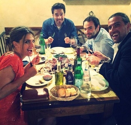 Stana Katic with three colleagues at the white team diner in the movie, 'Lost in Florence'..
